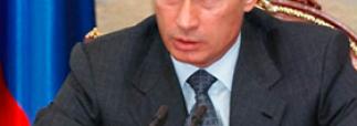 Путин отложил до лета 2012 года повышение тарифов на свет и газ